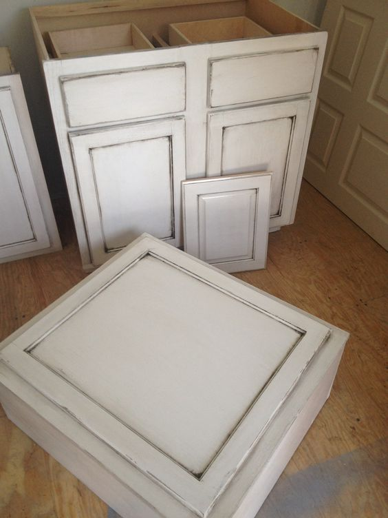Rustic cabinets unfinished cabinets sanded 2 coats of white valspar paint corners sanded - Antique white cabinets with black glaze ...