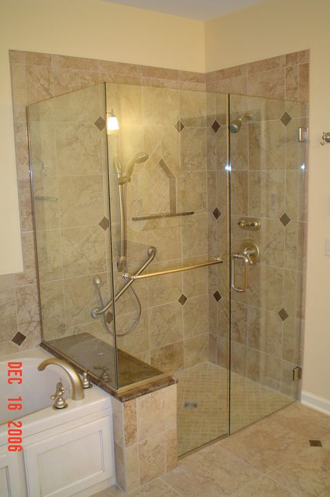 Tile shower stalls with seat shower enclosure with buttress panel separating tub from Tile shower stalls
