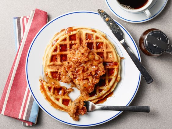 Sweet-Hot Fried Chicken and Waffles : Amanda serves her buttermilk fried chicken over a hot cheddar waffle and tops the whole thing off with a drizzle of her Sweet-Hot Maple Glaze: a combination of honey and maple syrup that's enhanced with chili powder, paprika, cayenne and more spices.