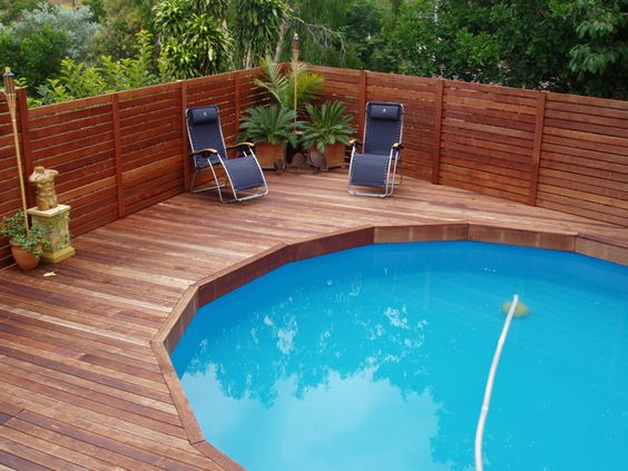 pool deck framing pics | Kwila deck built ontop of an above ground pool w/ a Kwila slat screen ...
