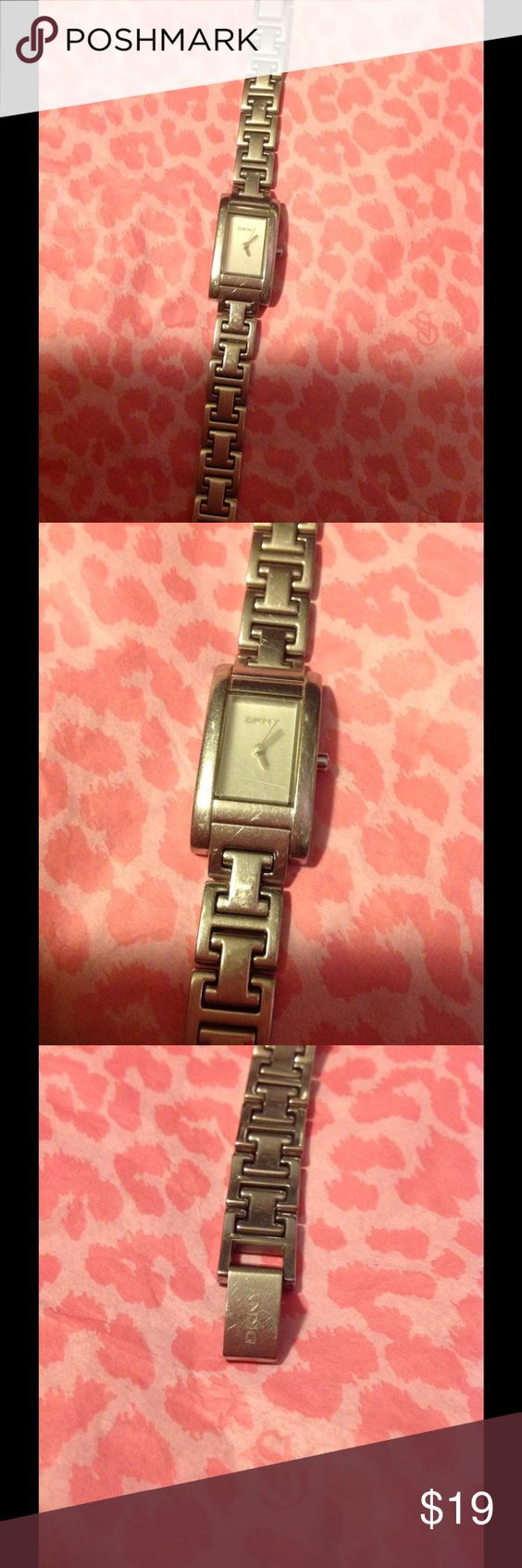 """DKNY Chainlink Watch Stainless Steel DKNY Chainlink Watch... Very much pre-loved many years ago... No harsh scratches, but can definitely see it was used & loved... 7"""" Long... Needs new battery since this classic piece hasn't seen light in many years... I am unable to track down the original box and its instructional book, which I know I've seen and paid no mind to... (Typical, mow that I'm in search of them both, which are not together, they're no where to be found!) A safe box will be used…"""