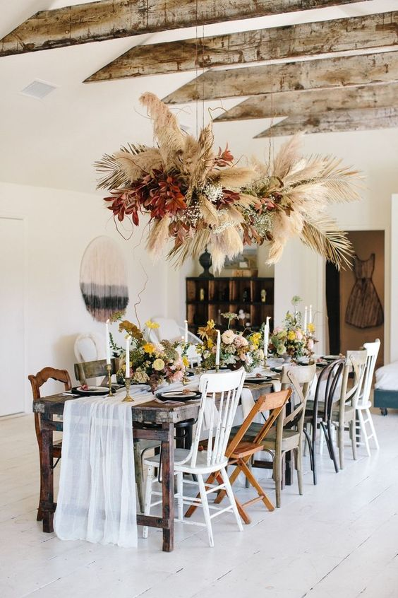 Well, the verdict is in! This vintage bohemian dinner party takes the cake for cutest of all time. With an upscale Southern feast, a wheat and burgundy floral chandelier and the most darling collection of mismatched chairs, you will not want to miss the beauty in store. We are pretty sold on the open beam living room too! #ruffledblog
