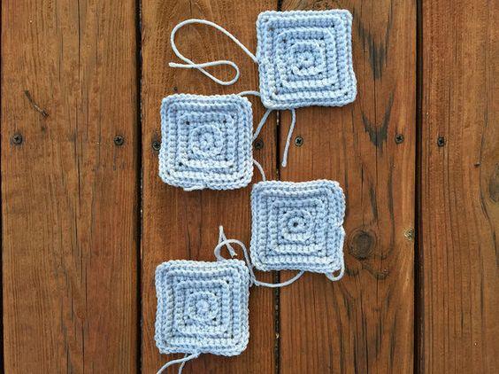 Four gray squares: http://www.crochetbug.com/a-slightly-slower-pace/