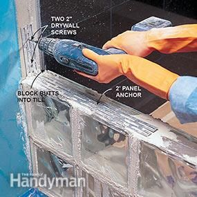 Fasten the glass block installation to the wall with panel anchors.
