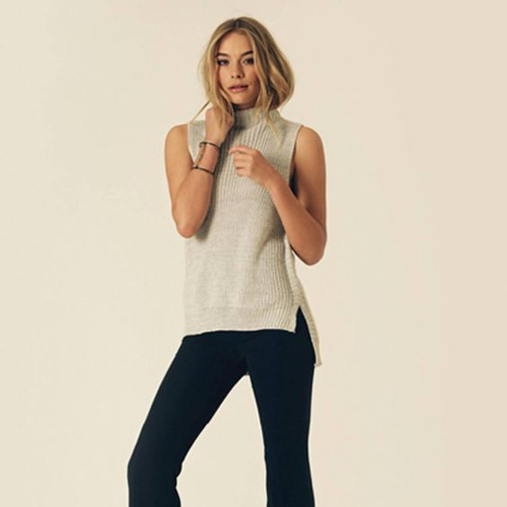 This year's flared denim completes the 70s vibe. Shop it at http://smitherystyle.com/collections/new-arrivals/products/gemma-sleeveless