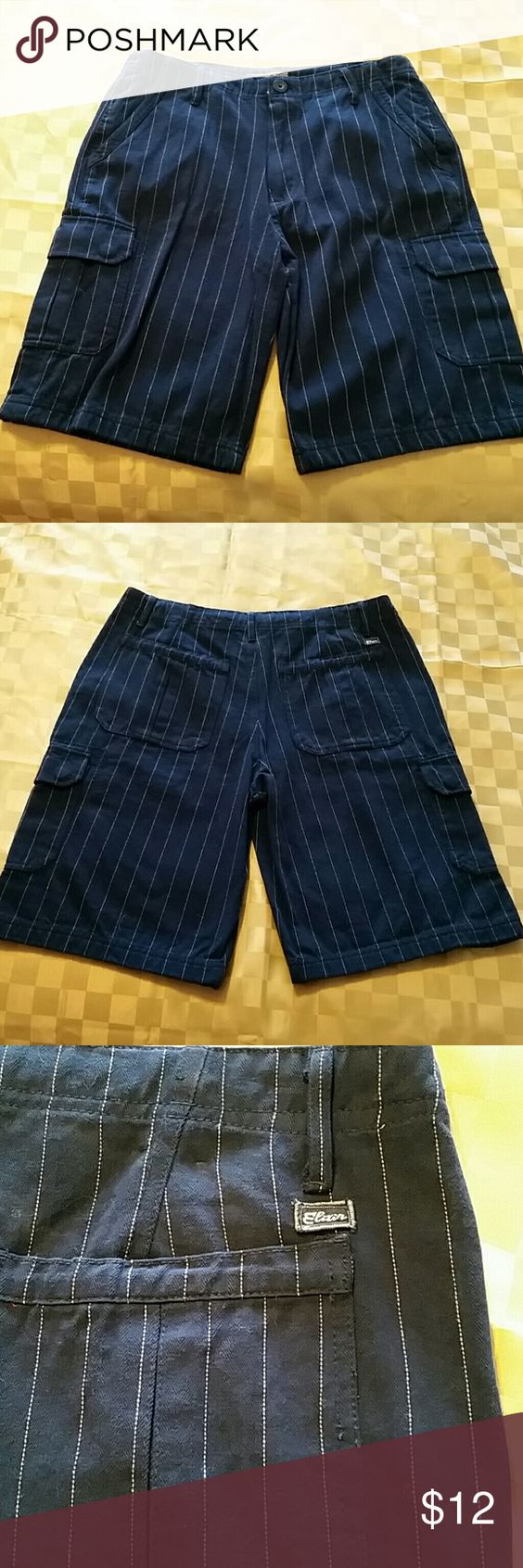 Men's Pinstripe Shorts Size 32, Navy Blue with a white pin stripe, also has cargo/side pockets. In great condition as they worn only one time. Elixer Shorts Cargo
