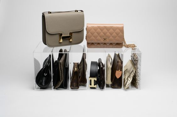 theGLAMdivide is the ultimate organizer/display for all of your clutches.  Great way to see everything you have and stay organized! glamboxes.com