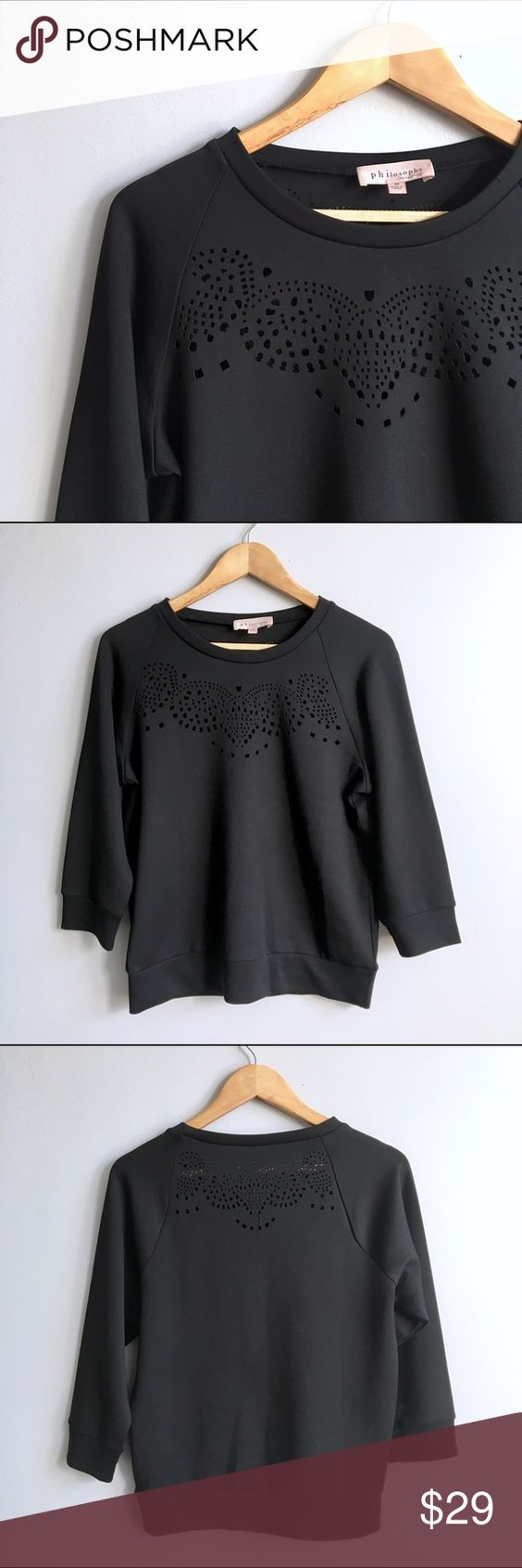 Philosophy Top Sweatshirt style Philosophy pull over with decorative cutouts on upper back and chest. In excellent condition. Across the chest 20 inches. Shoulder to hem 24 inches. Medium but can fit large. Check measurements. Polyester spandex blend. Anthropologie Tops