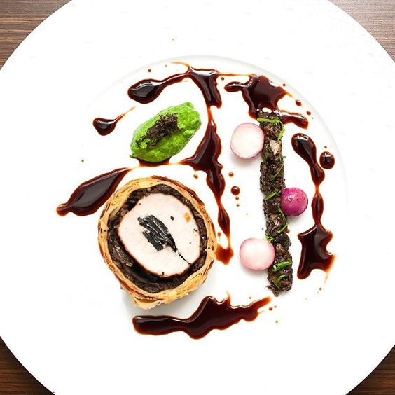 Truffled pork Wellington spinach purée mushroom ragout cherry gastrique by lennardy