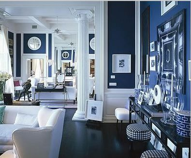 painting the walls blue and using white on the trim furniture creates a dramatic blue and white furniture
