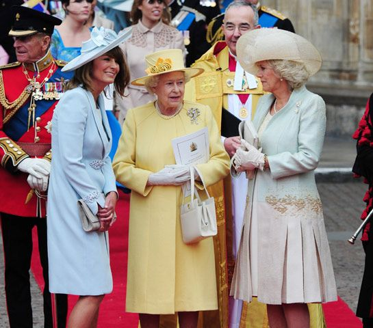 April 29, 2011: The bride's mother Carole Middleton, HM Queen Elizabeth II and Camilla, Duchess of Cornwall stand outside Westminster Abbey after the royal wedding of Prince William and Catherine Elizabeth Middleton.