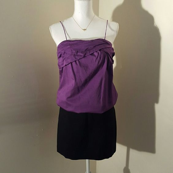 Purple spaghetti strap blouse 'Barney' purple spaghetti strap blouse with a very subtle sheen. Asymmetrical ruched bust. Side zipper. This is a great top for wearing under a blazer for work or dress it up by pairing with my bebe charcoal pencil skirt, j brand skinny jeans, or rockstar skinny pants!!Add a string of pearls and cute pumps and you're good to go!! I do custom bundles on 2+ items. GO Intl Tops