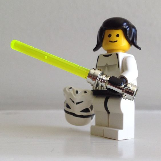 This is Princess Leia, disguised as a Stormtrooper, wielding a lightsaber, as seen in the Empire Strikes Back. According to my 3yo daughter.