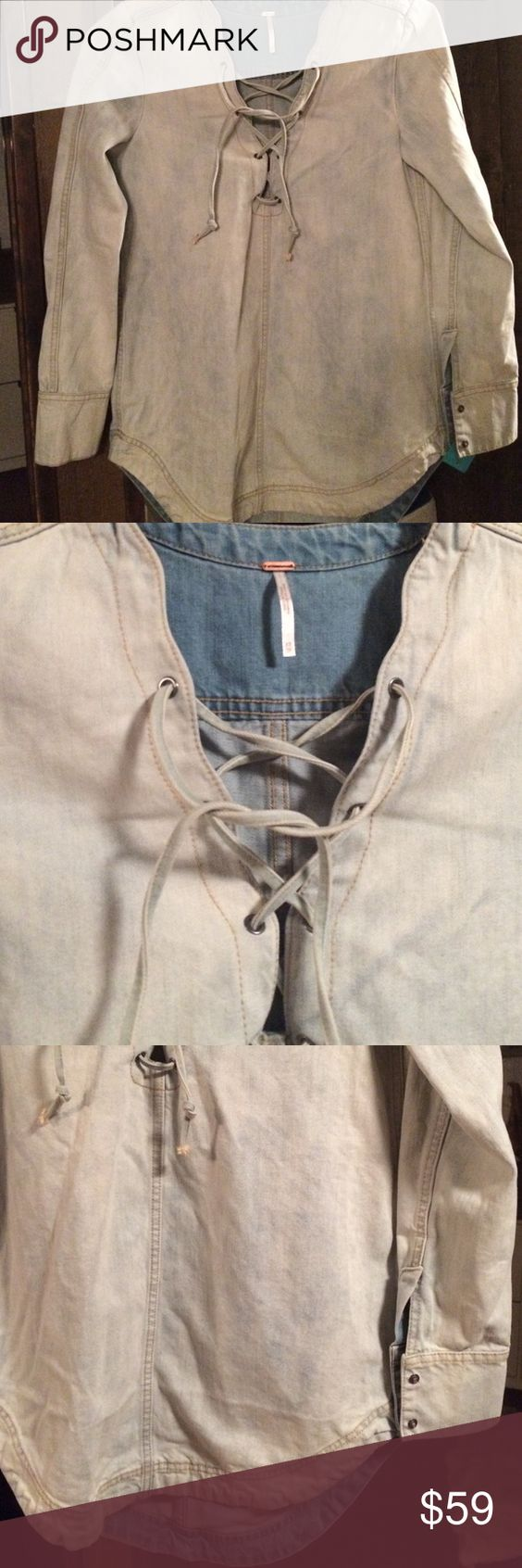 Free People jean lace up tunic SZ XS  NWOT Light jean colored tunic  criss cross ties up front two buttoned cuffs. Scooped bottom sz  XS. New. No tag. By Free People Free People Tops