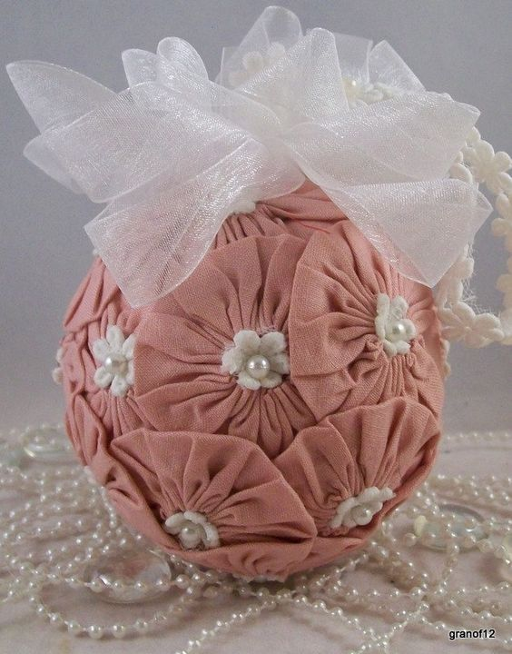 Victorian Style Christmas Ornament, Made from Yoyo's and accented with white flowers and pearls 20% Off. $22.00, via Etsy.