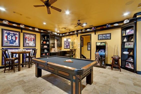 Man Cave Playroom : Randy likes the shelf at ceiling to display his