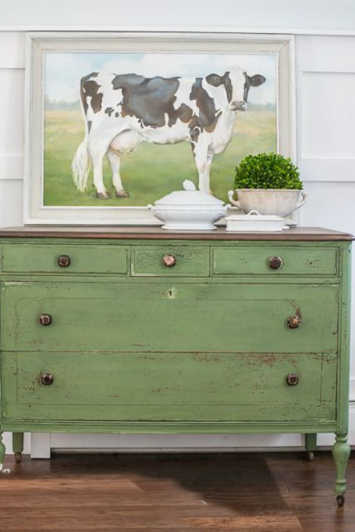 Decorating ideas and Spring inspiration! Cheery Spring green painted chest with painting of cow above it. Vintage French Soul ~