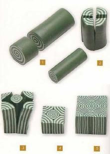 Simple makes complex. #Polymer #Clay #Canes-i made in gold and black. Nice pattern even on rounds. Kak