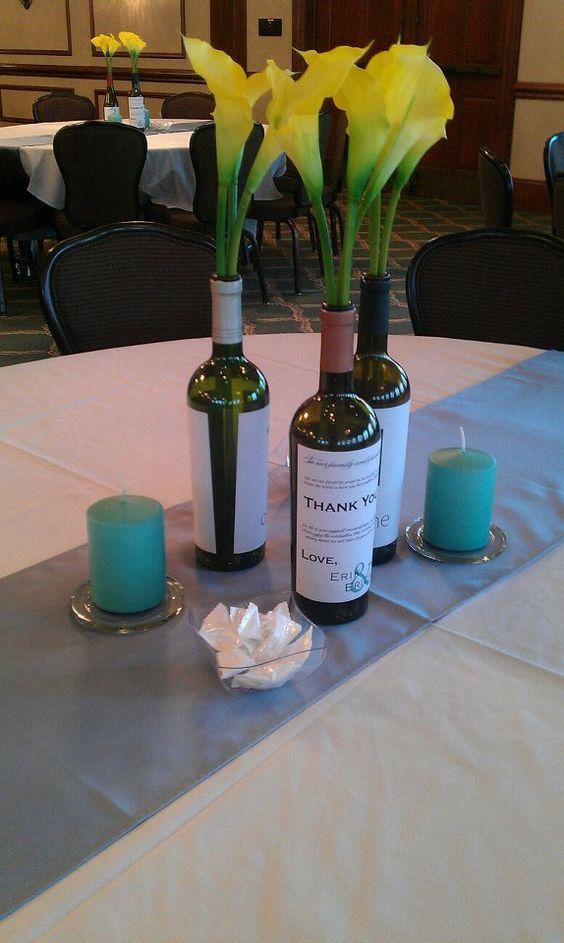 Love this unique centerpiece.  Use wine bottles instead of vases!  #wedding