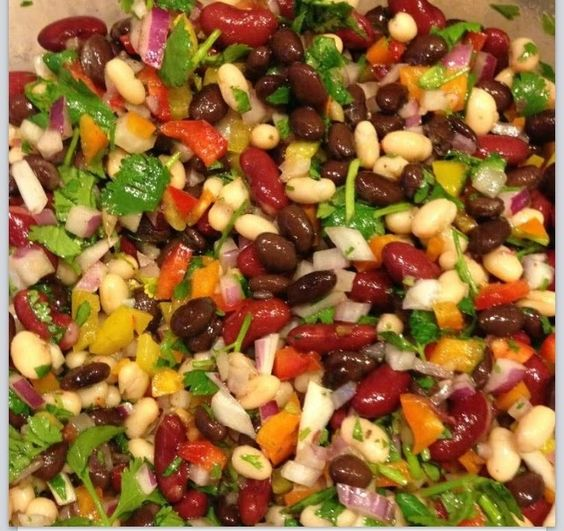 The best 3 bean salad - 1 - 15 oz can black beans 1 - 15 oz can kidney beans 1 - 15 oz can cannellini beans 2 peppers chopped (I used about 2/3 of a red, orange and yellow pepper, you can also use green) 1 red onion finely chopped 1/4 c olive oil 1/4 c red wine vinegar 2 T lime juice (fresh is best) 1 T lemon juice 1 T salt 1 clove crushed garlic 1 bunch of chopped cilantro chili powder and pepper to taste