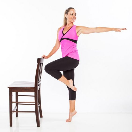 Grab a chair and sculpt your legs and abs with this home barre exercise