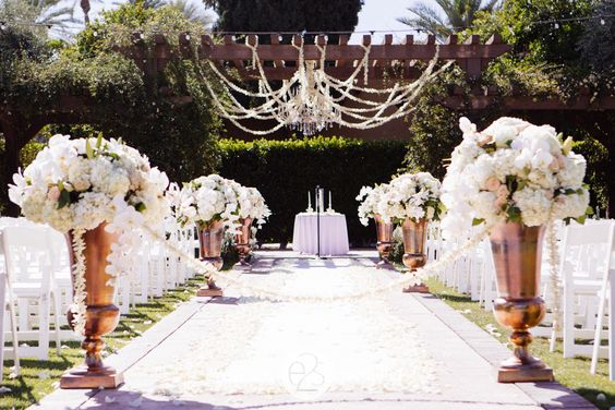 Wedding ceremony at the Wigwam Resort and Spa in Litchfield Park, Arizona. Blush, ivory, white and bronze floral.  Design and Floral by Thee Wedding and Event Warehouse  www.eyes2see.com