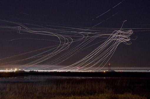 Planes landing light rays at night in SF international