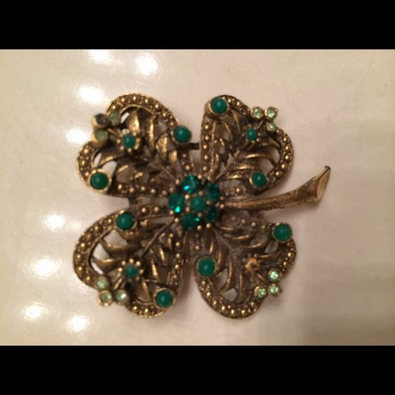 Vintage gold green tree brooch Vintage brooch in the design of tree with green  stones.  At least 2 stones are missing; but the quality of the brooch is good.  See back.  Wear with scarf and the folds of scarf cover any flaws  and still showcase beauty. Jewelry Brooches
