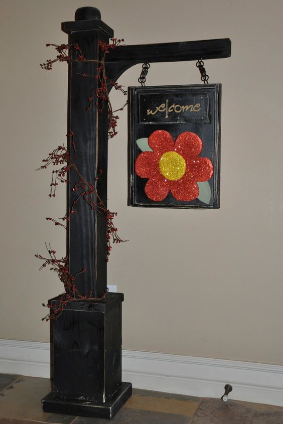 sign hanger....great idea for a wreath holder too!!