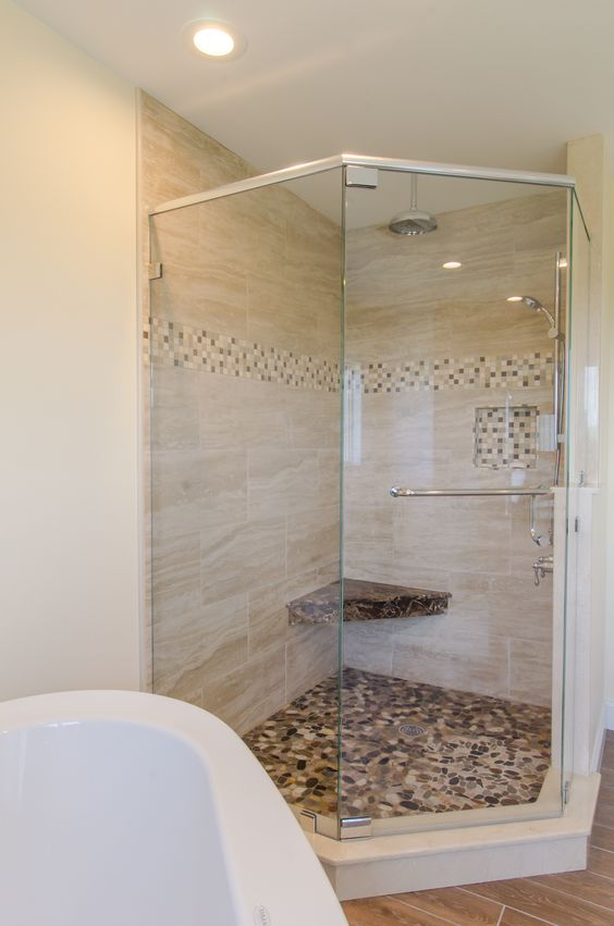 Shower Ideas - large custom tile shower with large tile walls with small glass tiel accent, built in cubbie and corner shower seat.