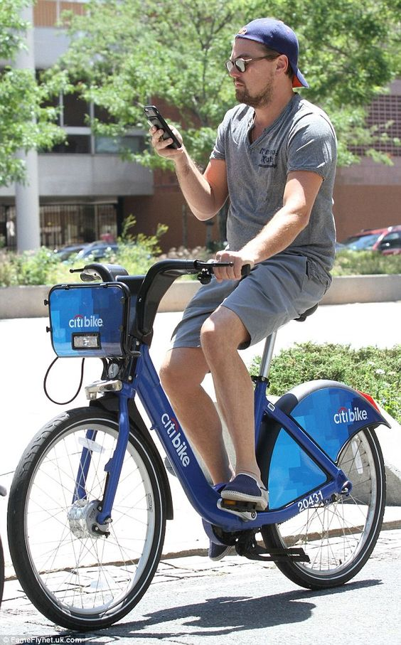 Leonardo DiCaprio scans his phone while riding New York Citi bike | Daily Mail Online: