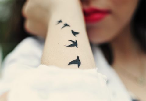 . normally I'm over these, but this one is good. Stark, delicate bird shape, only a couple, and on the back of arm. Yes.