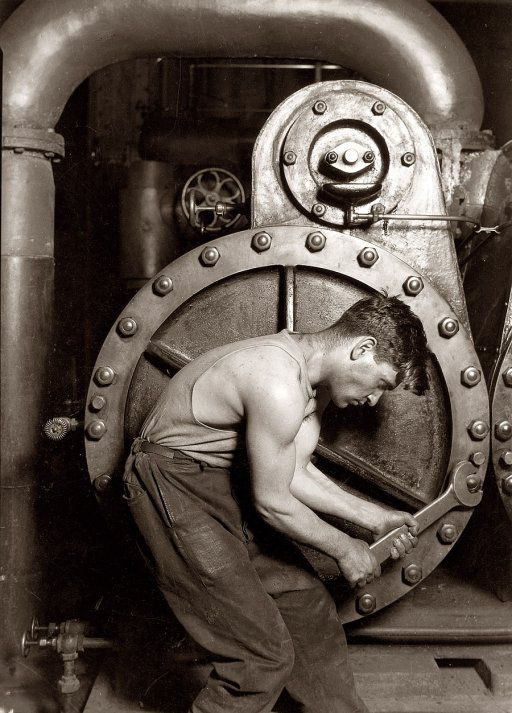 "Powerhouse Mechanic and Steam Pump (1920). One of Lewis Wickes Hine's celebrated ""work portraits"" made after he completed his decade-long project documenting child labor."