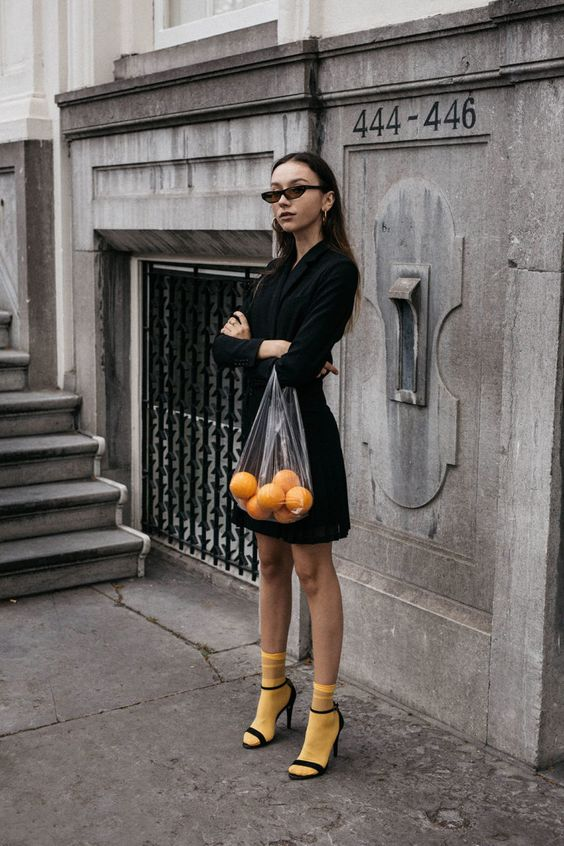 How to wear bright yellow socks with strappy sandals and all black Balenciaga 2017 sunglasses outfit matrix aesthetic conceptual editorial oranges in plastic bag