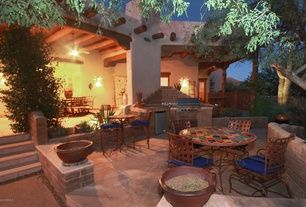 Rustic Patio with Outdoor kitchen, Raised beds, exterior stone floors, Fence, Pathway