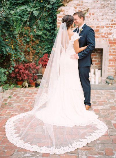 That veil is just wow! http://www.stylemepretty.com/2015/06/05/romantic-race-religious-new-orleans-wedding/   Photography: Nicole Berrett - http://www.berrettphotography.com/