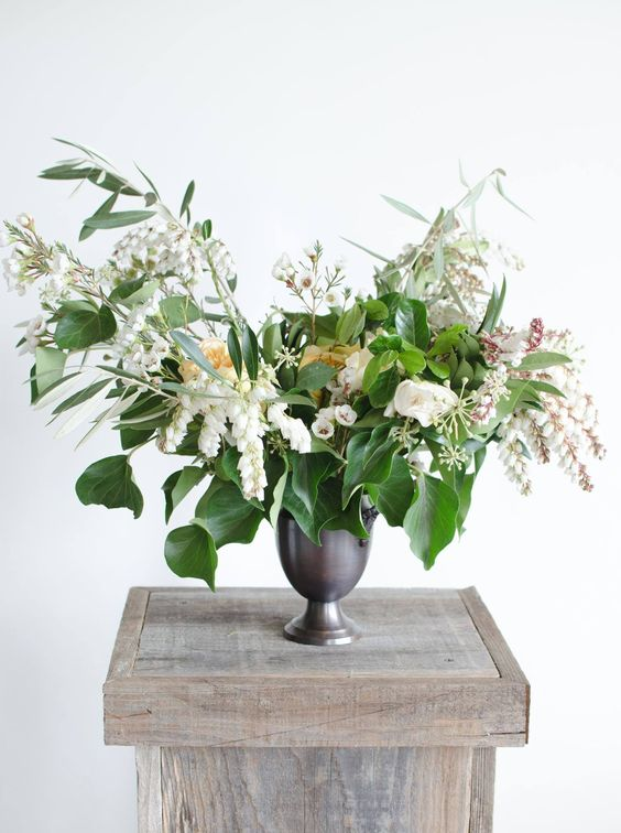 Fun little arrangement in a petite bronze urn. | by Gavita Flora. #white #wedding #flowers