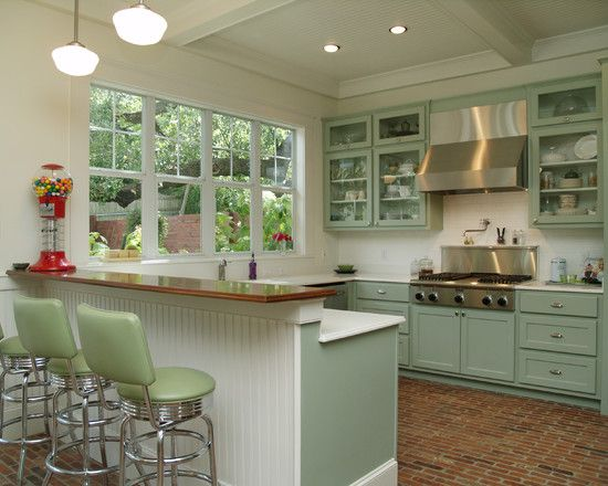 Lovely! I love the brick floor (never seen that before), the beadboard and the color of the cupboards. Lots of windows too!