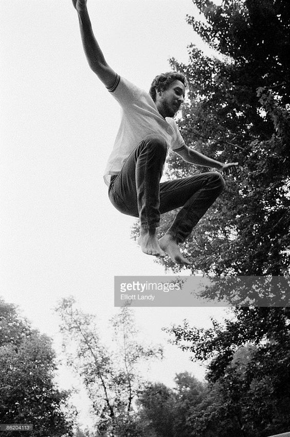 Jan 1970 WOODSTOCK Photo of Bob DYLAN, jumping - at home on Ohayo Mountain Road