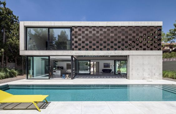 In Praise of Shadows is a private home located in Tel Aviv, Israel. Completed in 2014, it was designed by Pitsou Kedem Architects