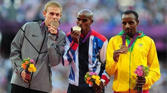 Medallists pose during 10,000m Victory Ceremony. Galen Rupp!!