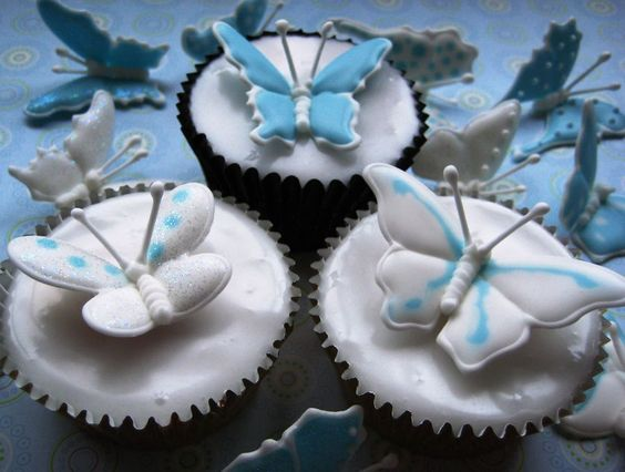 Vanilla cupcakes, with poured fondant icing, royal iced run out butterflies with edible glitter on top. time consuming but effective :)
