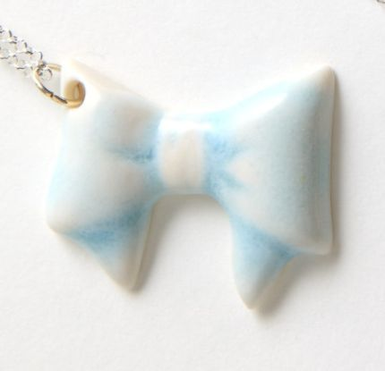 BOW NECKLACE - An adorable baby blue porcelain bow, made in the UK with love and care.   The glazed porcelain bow measures approximately 3.5cm across and sits on a 55cm sterling silver chain.  www.lumleylocket.com