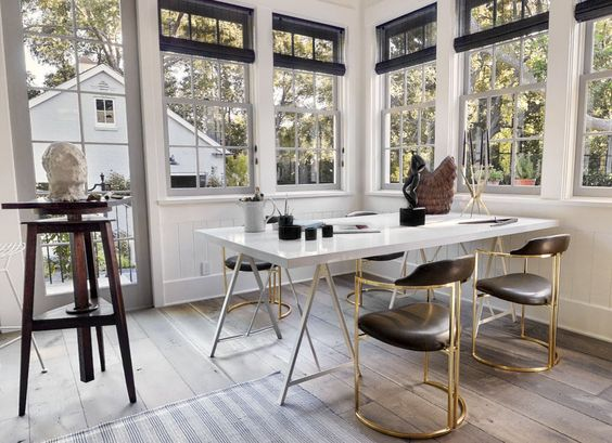 natural light, huge desk & open workspace (& i love those chairs!)