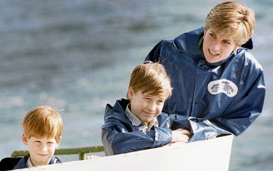 October 1991: Diana, William and Harry enjoy a ride on the Maid of Mist in Niagara Falls, Ontario, Canada