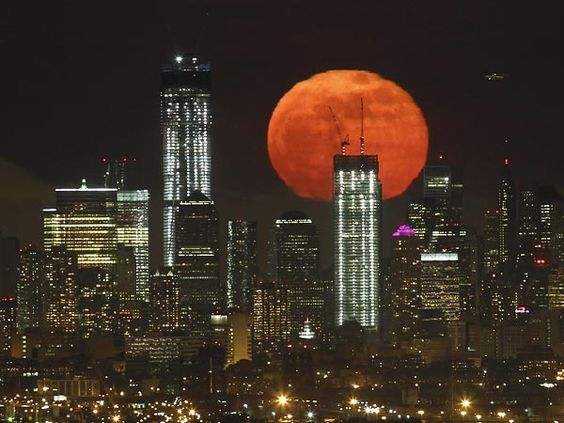 Super Moon over NYC by Gary Hershom, Reuters via National Geographic: Manhattan Skyline, Favorite Places Spaces, World Trade Center, Supermoon 2012, Super Moon, Full Moon, New York City