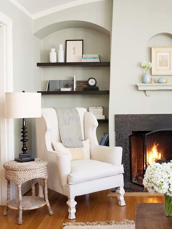 paint color.  floating shelves beside fireplace, woven side table, details on wingback chair