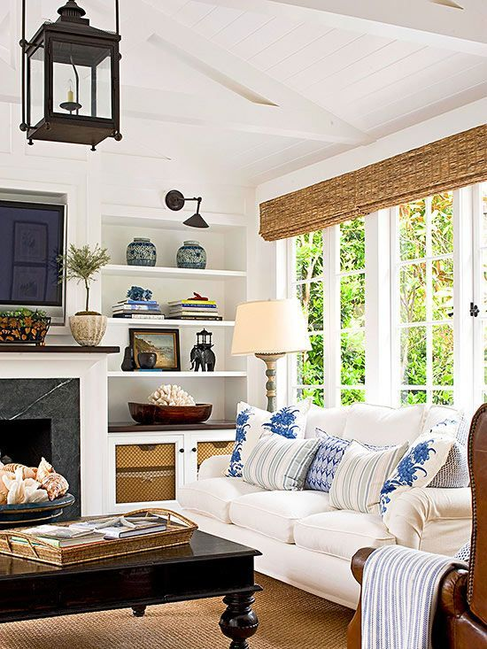 Blue White and Black Living Room with Built Ins Around Fireplace: