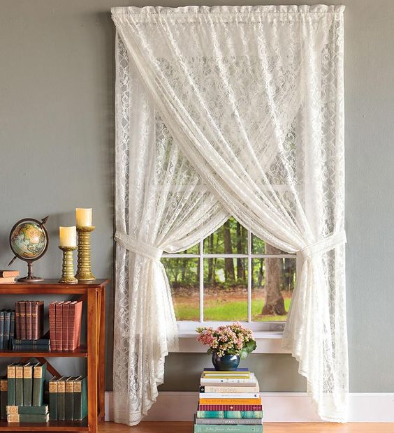 This is a beautiful way to dress a window. I love the criss cross patterned sheers.: