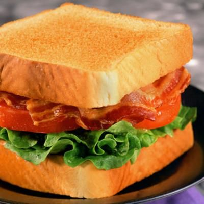 BLT  Start up the old George Foreman Grill to make quick work of that bacon, put bread in the toaster and slice up a beefsteak tomato and iceberg lettuce. Assemble, top with mayo, salt and pepper and serve with salad... viola!